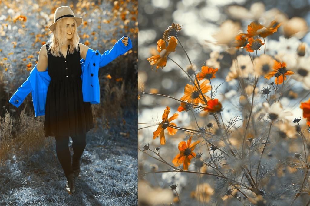 Christina Key lächelnd auf einer Wiese in einem schwarzen Kleid und einem blauen Blazer