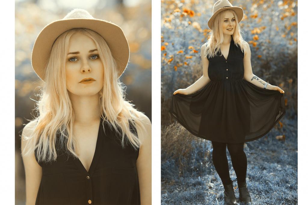 Fashion Bloggerin Christina Key steht lächelnd auf einer Blumenwiese und trägt dabei einen braunen Hut und ein sommerliches Kleid