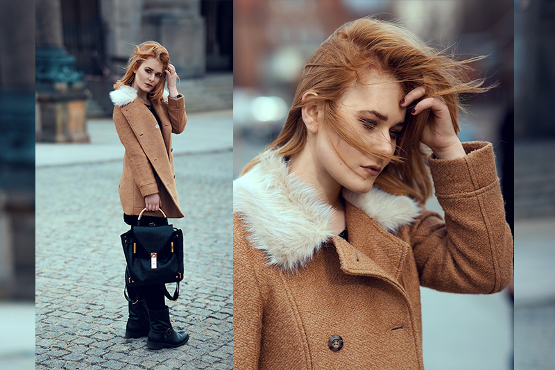 Christina Key is wearing red hairs and a brown winter jacket in Berlin