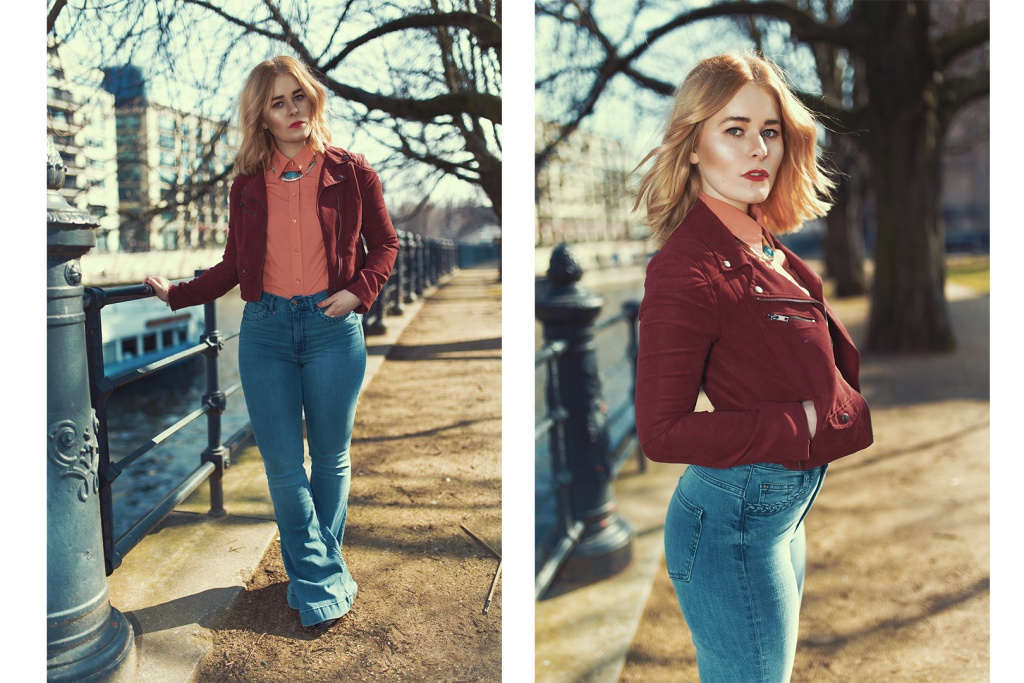 Blonde fashion blogger Christina Key is wearing a chic jacket in red and a blue pants