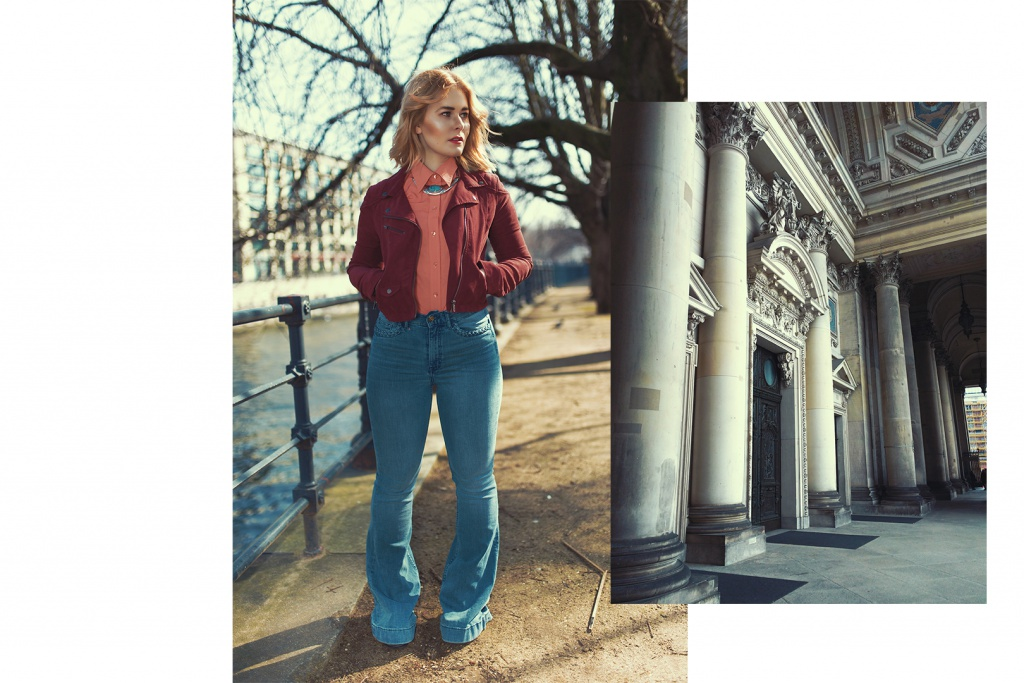 Fashion blogger Christina Key is wearing a high waisted pants and a bordeux red jacket