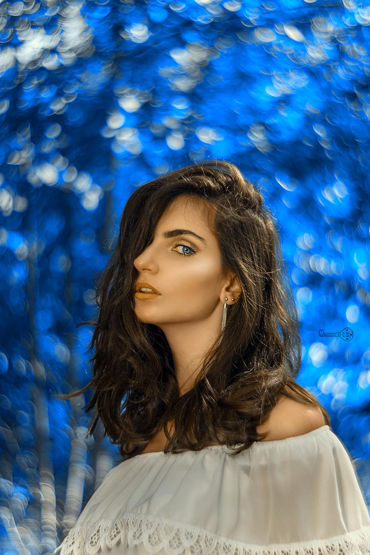 portrait-woman-swirly-bokeh-blue